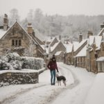 english countryside winter cotswolds castle combe in snow snowmaggedon england katya jackson whippet