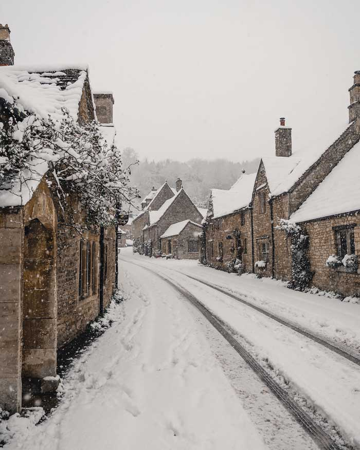 english countryside winter cotswolds castle combe in snow snowmaggedon england village katya jackson