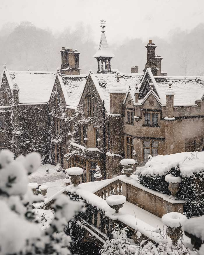 english countryside winter cotswolds castle combe manor in snow snowmaggedon england village katya jackson